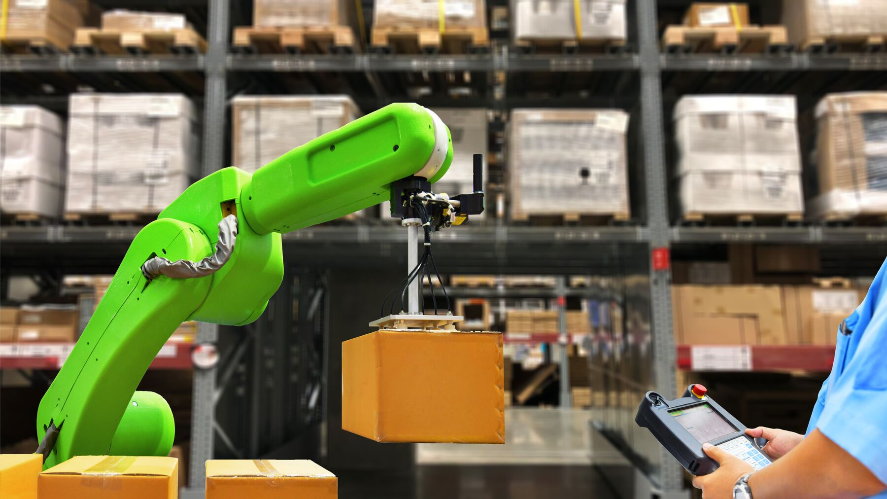 DPM-Robot_carries_box_in_warehouse